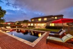 Custom-Gilbert-Real-Estate-Pool-Twilight-Monsoon-Image-By-Phoenix-Arizona-Architectural-Photographer-Kirk-Krein